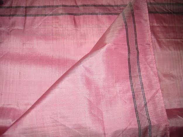 This pink silk neckerchief was made by weaving two different colors of silk threads to create the illusion of iridescence. (From the collection at the Shaker Heritage Society, gift of Virginia Ward.)