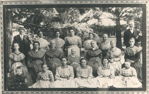 A photo of the South Family c. 1920. Anna Goepper is in the back row, fourth from the left.